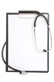 Black plastic clipboard with blank paper sheet and stethoscope Royalty Free Stock Images