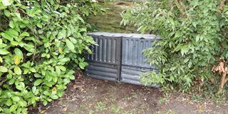 Plastic composting bin for Making compost from green waste. Black plastic composting bin for Making compost from green waste Royalty Free Stock Photo