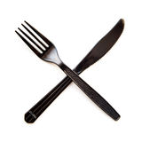 Black plastic crossed  fork and knife isolated Stock Photo