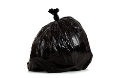 Black plastic garbage bag on white Royalty Free Stock Photography