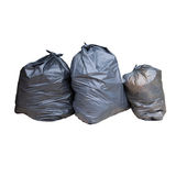 Black plastic garbage isolated white Stock Images