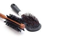 Black  Plastic Hairbrush with Wooden Hairbrush Royalty Free Stock Photography