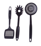 Black plastic kitchen utensil isolated on white Stock Photos
