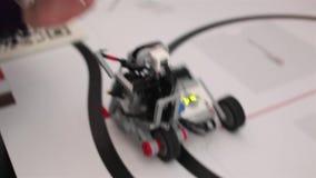 Black plastic mechanical robot on bike stock video footage