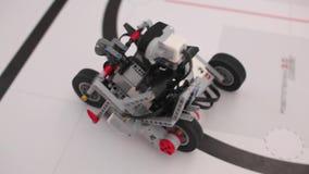 Black plastic mechanical robot on bike stock footage