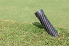 The black plastic pipe tip under the meadow in golf course for w. The black plastic pipe tip under the meadow in green golf course for water draining stock images
