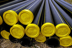 Black plastic pipes with yellow caps Royalty Free Stock Photos