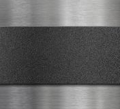 Black plastic plate over metal panel Royalty Free Stock Photography