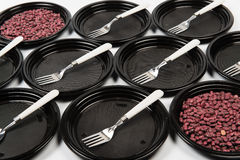 Black plastic plates with forks and haricot Royalty Free Stock Photo