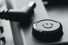 Black plastic power on off button with power adjustment. 12 volt plug stock photography
