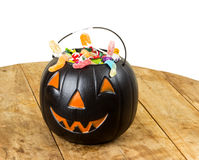 Black plastic pumpkin on wooden table Stock Image