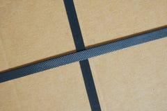 Black plastic strap box. In cross shape stock photos