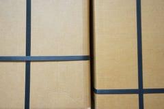 Black plastic strap box. In cross shape royalty free stock photo