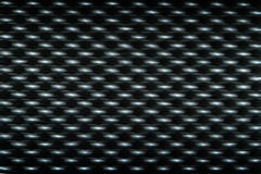 Black plastic surface with rough texture of blur Stock Photography