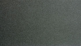Black plastic textured surface Royalty Free Stock Photo