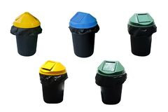 Black plastic trash with green, yellow, blue lid. To separate categories such as recycle, fresh garbage, general waste.  isolated stock image