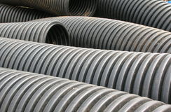 Black plastic tubing abandoned outdoors Stock Images