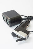 Black plastic usb and lighter charger for car Royalty Free Stock Photos