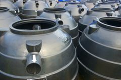 Black plastic water storage tanks Stock Images