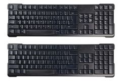 Black plastic wireless computer keyboards with symbols and without isolated on white background stock images