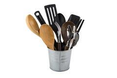 Black plastic, wooden, metal kitchen set skimmer, spade of fryin Stock Images