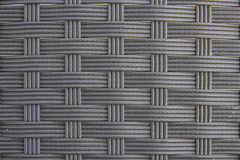 Black plastic woven with patterns. Royalty Free Stock Photo