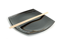 Black plate. Diet concept - empty black asian plate and chopsticks Stock Photo