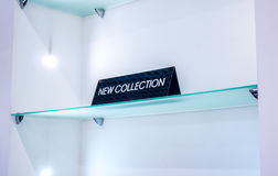 Black plate in a clothing store with a sign NEW COLLECTION Stock Images