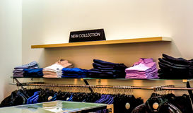 Black plate in a clothing store with a sign NEW COLLECTION royalty free stock photo