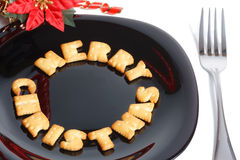 Black plate with cookies, fork and decoration Stock Image