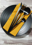 A black plate with cutlery Royalty Free Stock Photos