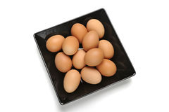 Black plate with eggs Stock Image