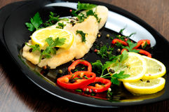 Black plate with fish meat Royalty Free Stock Images