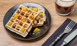 Black plate with homemade waffles, tangerines, chocolate Stock Images
