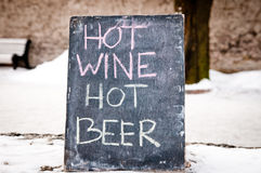 The black plate with the inscription HOT WINE HOT BEER Stock Photos
