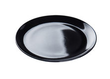 Black plate isolated. On background Royalty Free Stock Photo