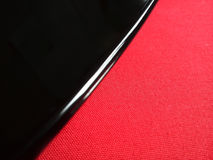 The black plate on red tablecloth Royalty Free Stock Image