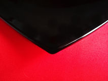 The black plate on red tablecloth Royalty Free Stock Images