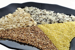 Black plate with rice, buckwheat, millet, porridge. Frome above Royalty Free Stock Photo