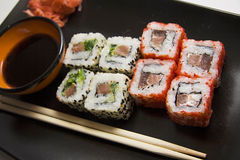 Black plate of rolls 8 Stock Photos
