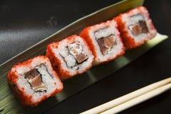 Black plate of rolls 4 Stock Photos