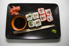 Black plate of rolls  Stock Images