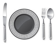 Black plate, silver spoon, fork, knife Royalty Free Stock Photos