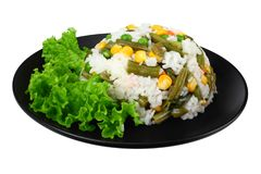 Black plate with white rice, green peas, canned corn kernels, cut green beans isolated on white background stock photo