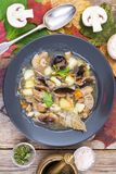 Black plate with wild mushroom soup Royalty Free Stock Photography