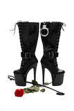Black platform boots with whip and rose Royalty Free Stock Photo