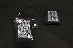 Black playing cards Stock Images