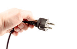 Black plug in hand Royalty Free Stock Photography
