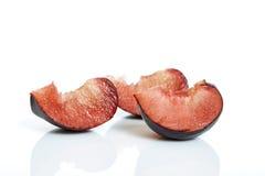 Black plum. Ripe black plum on white background Stock Images