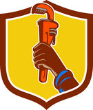 Black Plumber Hand Raising Monkey Wrench Crest. Illustration of a black plumber hand raising monkey adjustable wrench viewed from the side set inside shield Royalty Free Stock Photography